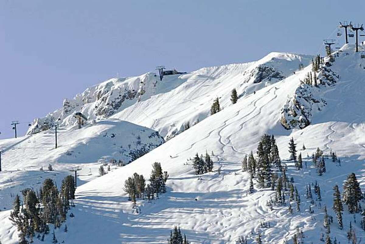 Skiers and riders get fresh tracks near Broadway Express.