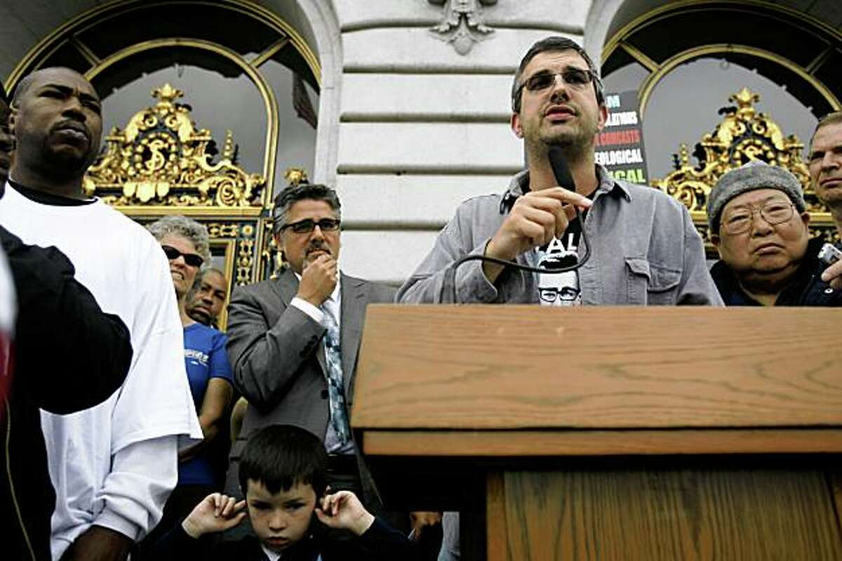 San Francisco Supervisor Chris Daly, second from right, address demonstrators outside San Francisco City Hall as hundreds gather in protest Mayor Gavin Newsom's budget in San Francisco, Calif. Wednesday June 10, 2009