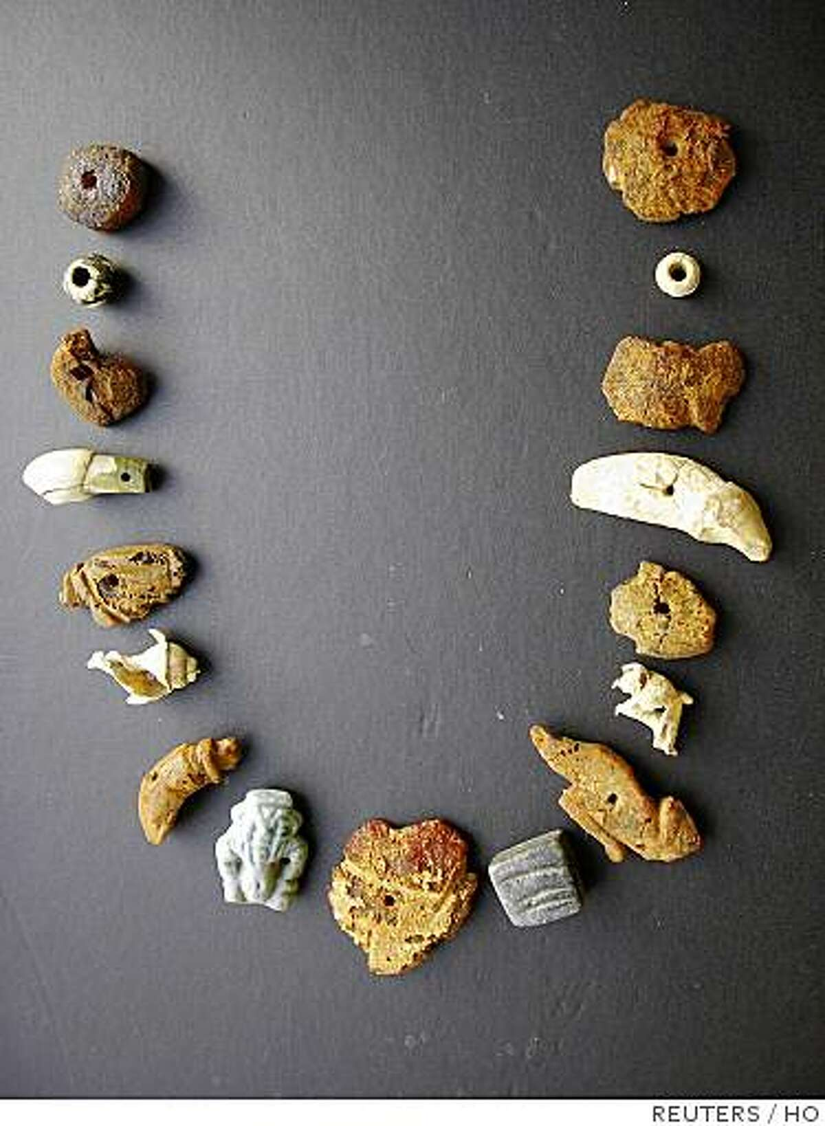 Part of a necklace, discovered in a necropolis on the outskirts of Rome, is shown in a photo released July 17, 2007. Archaeologist have discovered a nearly 2000-year-old intact necropolis on the outskirts of Rome that gives a rare insight into the lives of poor labourers in the Roman era, they said on June 9, 2008. REUTERS/Archaeology Superintendent of Rome/Handout (ITALY). FOR EDITORIAL USE ONLY. NOT FOR SALE FOR MARKETING OR ADVERTISING CAMPAIGNS.