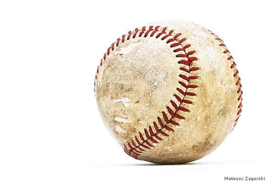 Dirty baseball isolated on white, close-upiStockphoto.com Photo: Mateusz Zagorski