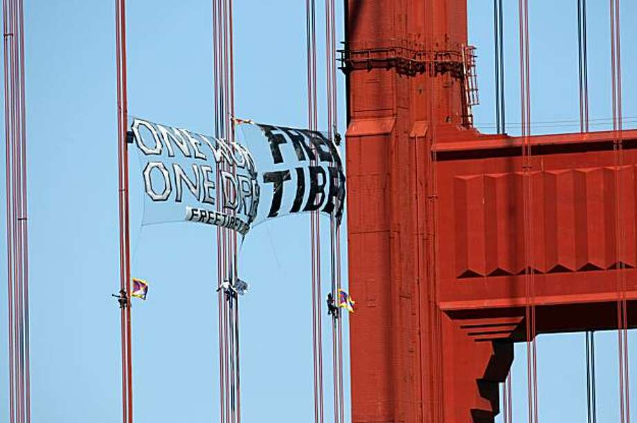Three demonstrators scale the Golden Gate Bridge on Monday, April 7, 2008 in a protest intended to draw attention to Chinese human rights violations in Tibet.   Photo by Laura Morton / Special to The Chronicle Photo: Laura Morton, Special To The Chronicle