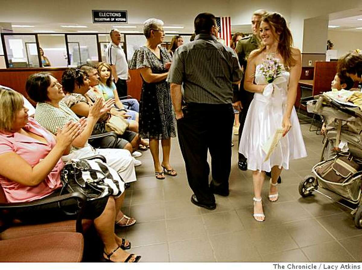 Lance Corporal Brandon Davis and bride Crysta Greer are applauded as they leave the Kern County Clerks Office after being married, Thursday June 12, 2008, in Bakersfield, Calif. Lacy Atkins /The San Francisco Chronicle