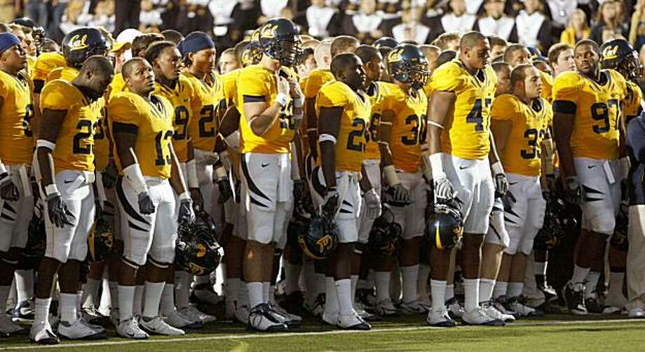 California football players watch as Jahvid Best (not shown) is removed from the field after scoring against Oregon State during the first half Saturday in Berkeley. Best was removed from the game on a gurney. Photo: Ben Margot, AP