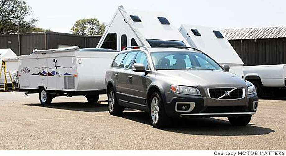 The Volvo XC70 wagon achieves good fuel economy while towing the Chalet fold-down camper.