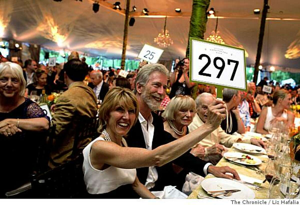 Left to right from foreground--Delia Viader, Tim Mondavi, and Marguerite Mondavi as they make sure signs are working at the start of the annual Auction Napa Valley taking place on the golf course at Meadowood Resort in St. Helena, Calif., on Saturday, June 7, 2008.Photo by Liz Hafalia/The Chronicle