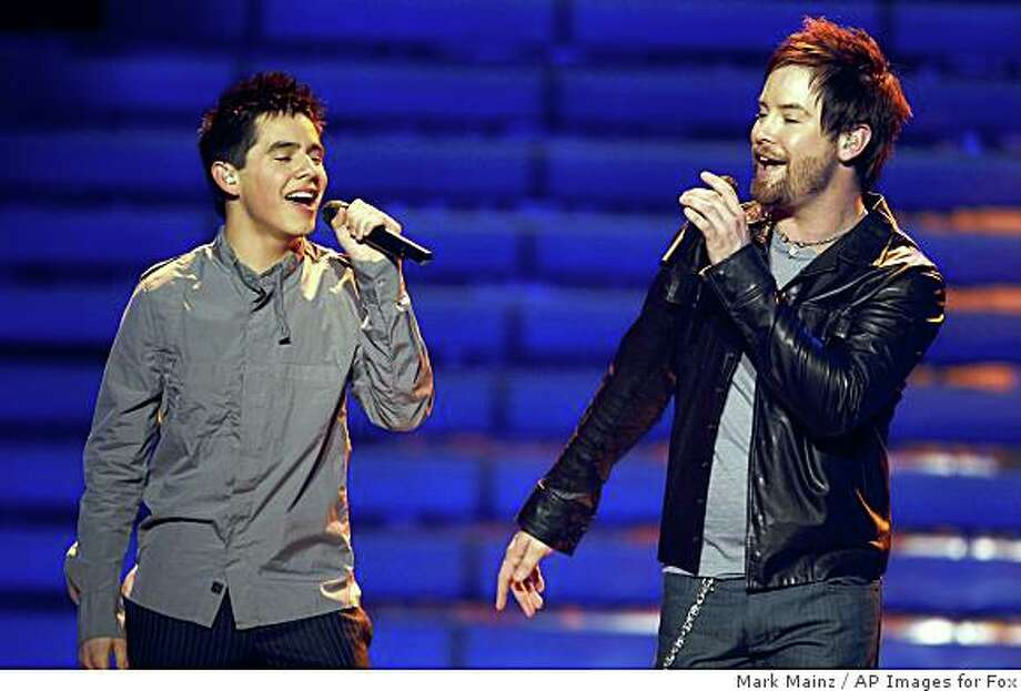 David Cook, right, and David Archuleta perform during the season finale of American Idol on Wednesday May 21, 2008, in Los Angeles. Photo: Mark Mainz, AP Images For Fox