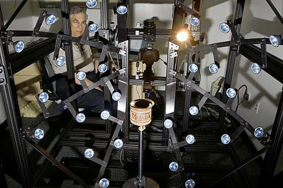ARTIFACTS: Ken Zuckerman shows the experimental Multi-View Apparatus -- also called the Gizmo -- which takes pictures of an artifact lighted from multiple angles. A computer composite then lets researchers adjust the light and shadows to reveal details. Illustrates ARTIFACTS (category a) by Duke Helfand (c) 2009, Los Angeles Times. Moved Monday, Nov. 2, 2009. (MUST CREDIT: Los Angeles Times photo by Genaro Molina.)  Ken Zuckerman shows the experimental Multi-View Apparatus -- also called the Gizmo -- which takes pictures of an artifact lighted from multiple angles. A computer composite then lets researchers adjust the light and shadows to reveal details. Illustrates ARTIFACTS (category a) by Duke Helfand (c) 2009, Los Angeles Times. Moved Monday, Nov. 2, 2009. (MUST CREDIT: Los Angeles Times photo by Genaro Molina.) Photo: Genaro Molina, Los Angeles Times