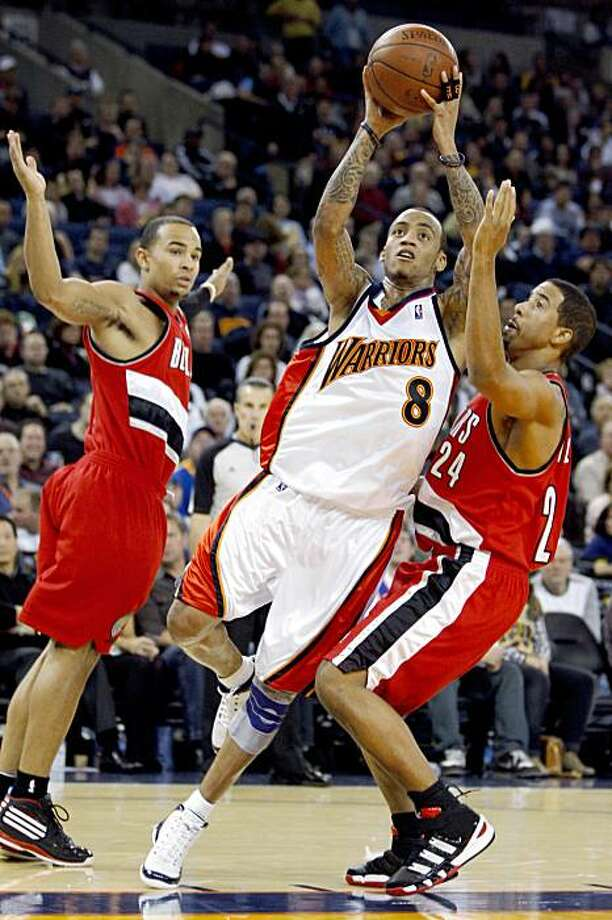 Golden State Warriors' Monta Ellis (8) drives past Portland Trail Blazers' Andre Miller during the second half of an NBA basketball game Friday, Nov. 20, 2009, in Oakland, Calif. (AP Photo/Ben Margot) Photo: Ben Margot, AP