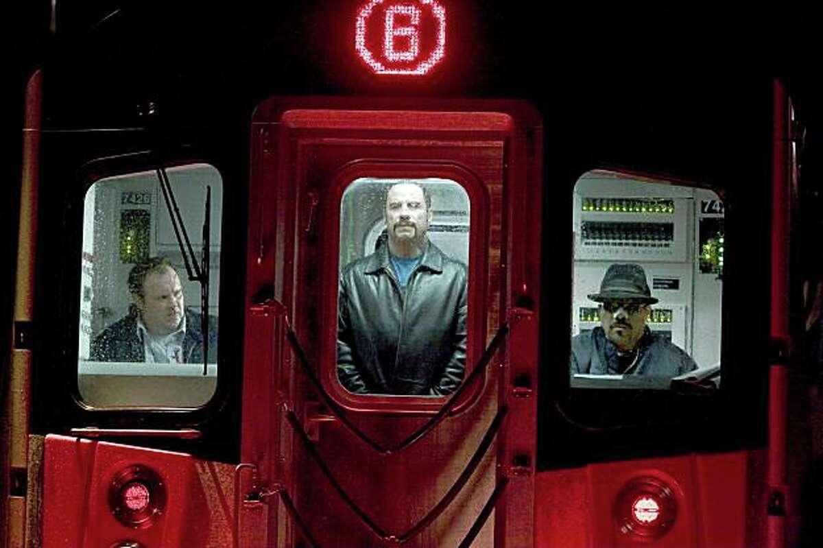 John Travolta, center, and Luis Guzman, right, in Columbia Pictures' action thriller THE TAKING OF PELHAM 123, also starring Denzel Washington.