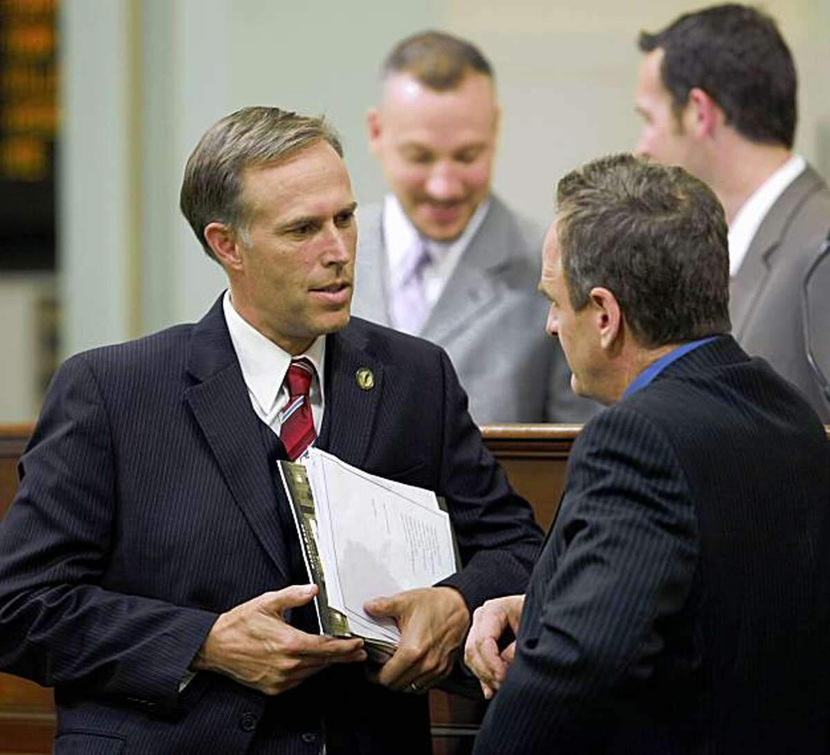 Assemblyman Jared Huffman, D-San Rafael, left, talks with Assembly Minority Leader Sam Blakeslee, R-San Luis Obispo, during the Assembly session at the Capitol in Sacramento on Monday. Huffman is carrying several water measures.