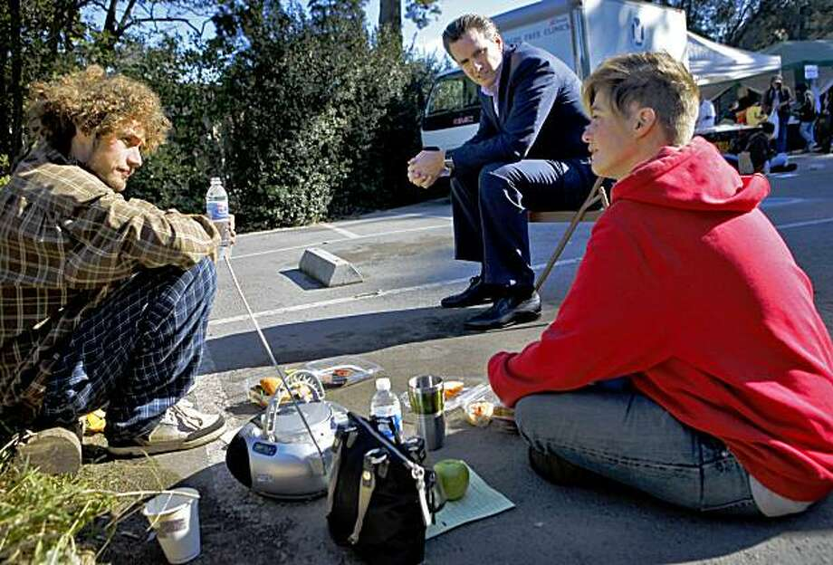 Mayor Gavin Newsom (center) talks to Jason Thomson ( left) and Jerry Zealand  while he was visiting the people that attended the Project Homeless  Connect, Thursday, Nov. 19, 2009, in the Golden Gate Park in San Francisco, Calif. Photo: Lacy Atkins, The Chronicle