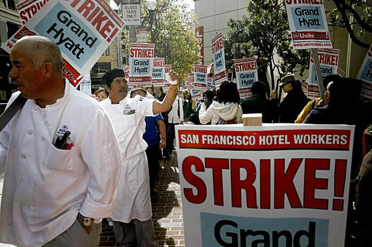Silveriano Pagtanac, a line cook at a nearby Hilton Hotel, waves his fist in the air as he joins other San Francisco Hotel workers picketing in front of the Grand Hyatt San Francisco on Thursday Nov. 5, 2009 in San Francisco, Calif. after a strike was called earl that morning.