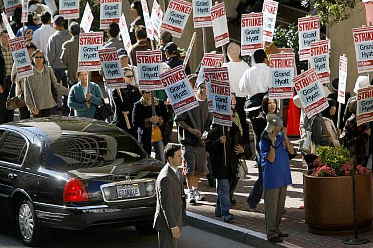 San Francisco Hotel workers picket in front of the Grand Hyatt San Francisco on Thursday Nov. 5, 2009 in San Francisco, Calif. after a strike was called earl that morning.