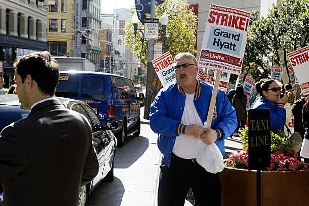 "Robert Lehr, a Hyatt bartender and waiter for 15 years, yells the word ""scab""  to a worker who helped a customer with her bags at the  in front of the Grand Hyatt San Francisco on Thursday  Nov. 5, 2009 in San Francisco, Calif. Photo: Mike Kepka, The Chronicle"