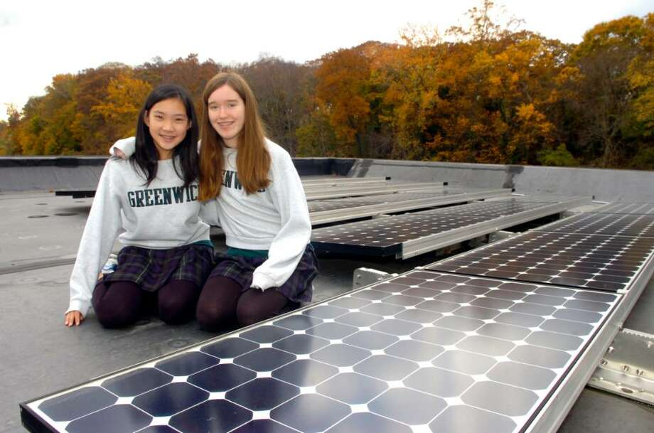 Greenwich, Nov. 5, 2009.  Alicia Kiley, 13, 8th grade and Caroline Zhao, 12, 7th grade, who head the greening committee, get a look at the roof of the Greenwich Academy Middle School. The school  was giving a tour of the new award-winning LEED-certified school building. Photo: Helen Neafsey / Greenwich Time
