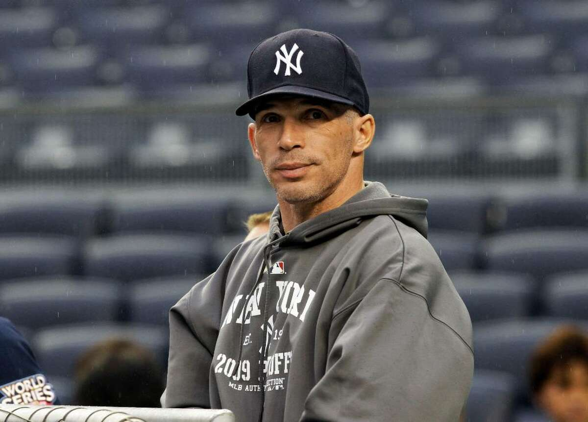 New York Yankees manager Joe Girardi looks around Yankee Stadium during a practice session for the Major League Baseball World Series Tuesday, Oct. 27, 2009, in New York. The Yankees play the Philadelphia Phillies in Game 1 of the World Series on Wednesday, Oct. 28, 2007. (AP Photo/Eric Gay)