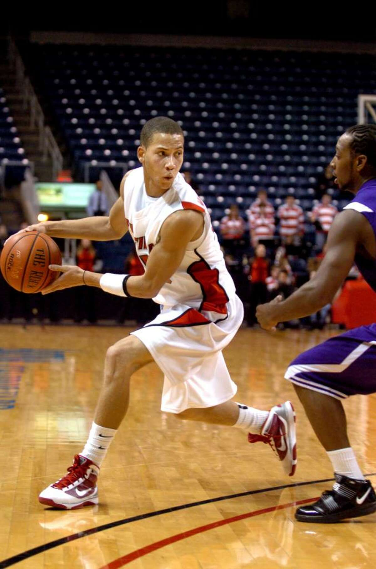 Fairfield University's Colin Nickerson looks for a hole to pass as Bridgeport University's Steve Martin defends during men's hoops at the Arena at Harbor Yard in Bridgeport.