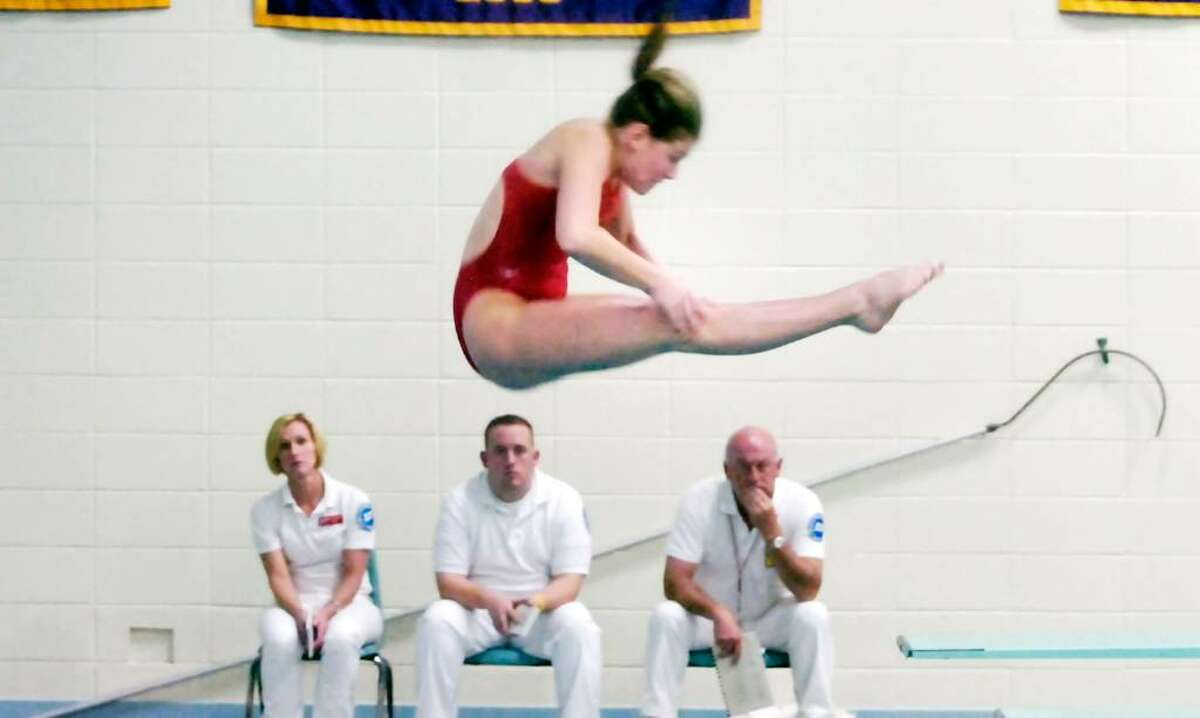 Greenwich diver Kara Capossela spins above the judges at Westhill High School Thursday afternoon, Nov. 5, 2009 during the FCIAC Girls Diving Finals.