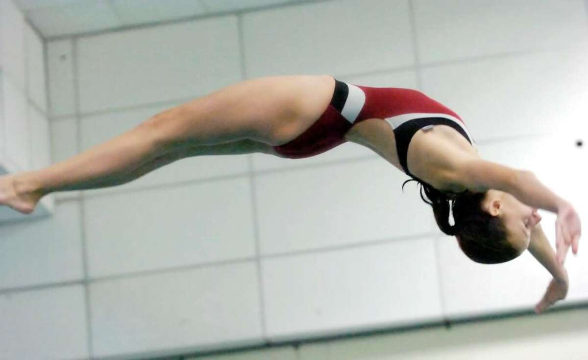 New Canaan diver Meredith Jonker competes at Westhill High School Thursday afternoon, Nov. 5, 2009 during the FCIAC Girls Diving Finals.
