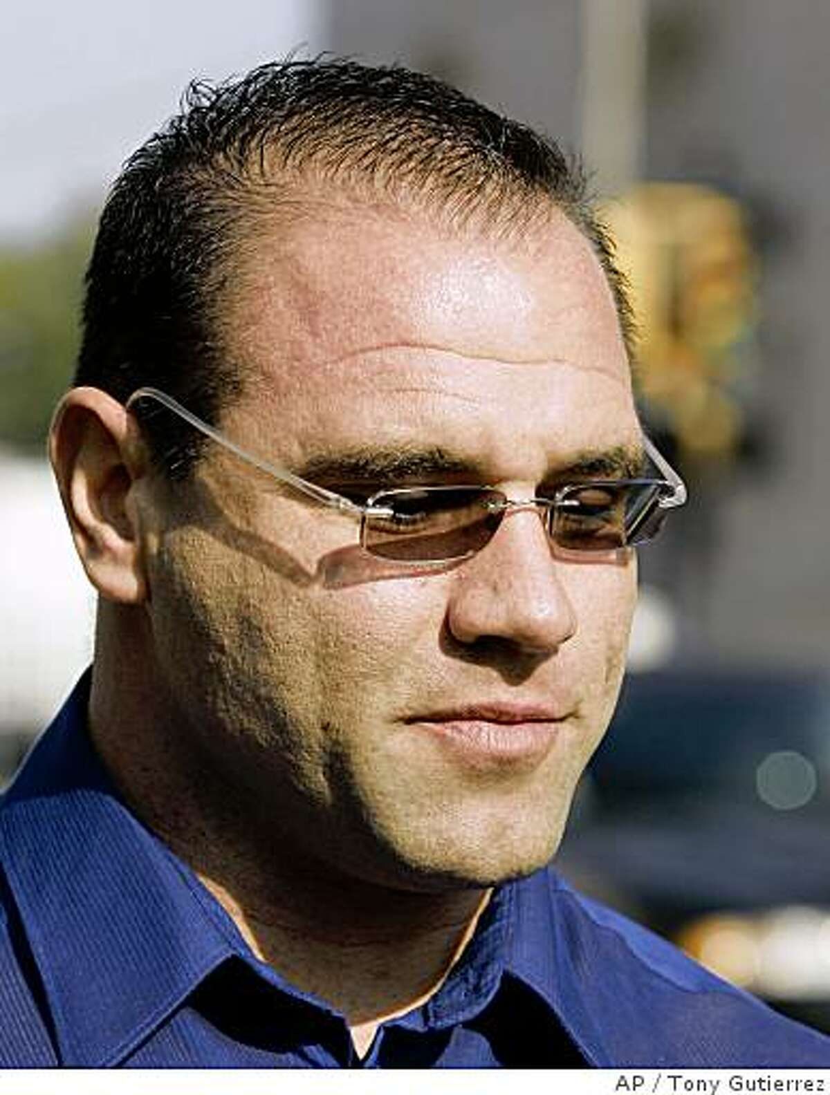 In this Nov. 13, 2007 file photo, David Jacobs of Plano, Texas, walks out of the federal courthouse in Sherman, Texas, after pleading guilty to federal charges of to conspiring to distribute thousands of units of anabolic steroids.