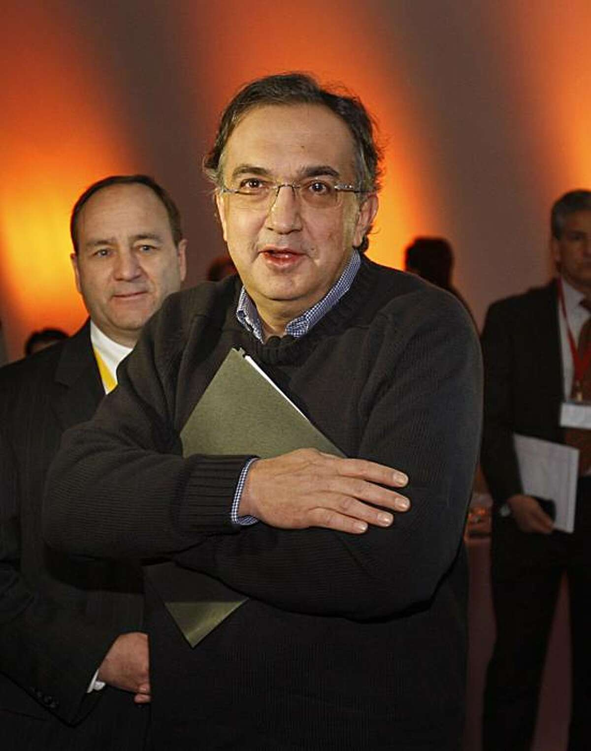 Chrysler Group LLC CEO Sergio Marchionne arrives for a news briefing at the automaker's headquarters in Auburn Hills, Mich., Wednesday, Nov. 4, 2009. (AP Photo/Carlos Osorio)