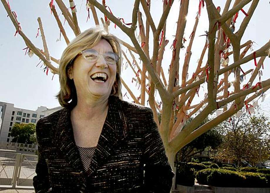 "Mary McCue enjoys a light moment beneath the ""wishing tree"" in the Children's Garden. Mary McCue runs the Yerba Buena Gardens in San Francisco, CA. Photo: Brant Ward, The Chronicle"