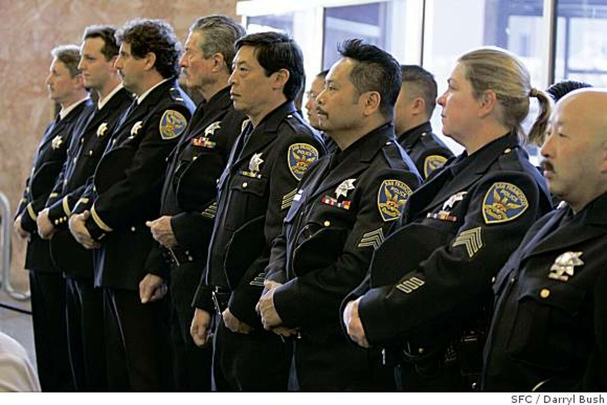 SFPD officers observe in silence the unveiling of the inscribed name of fallen San Francisco police officer, Bryan Tuvera, to the wall of honor which also says,