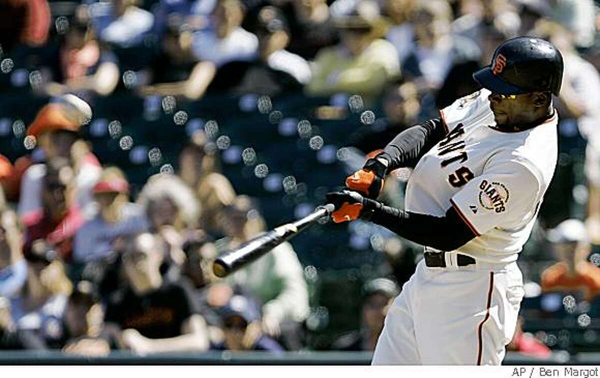 San Francisco Giants' Fred Lewis swings for a two-run, game-tying triple off San Diego Padres' Trevor Hoffman during the 10th inning of a baseball game Sunday, June 1, 2008, in San Francisco. The Giants won 4-3. (AP Photo/Ben Margot)