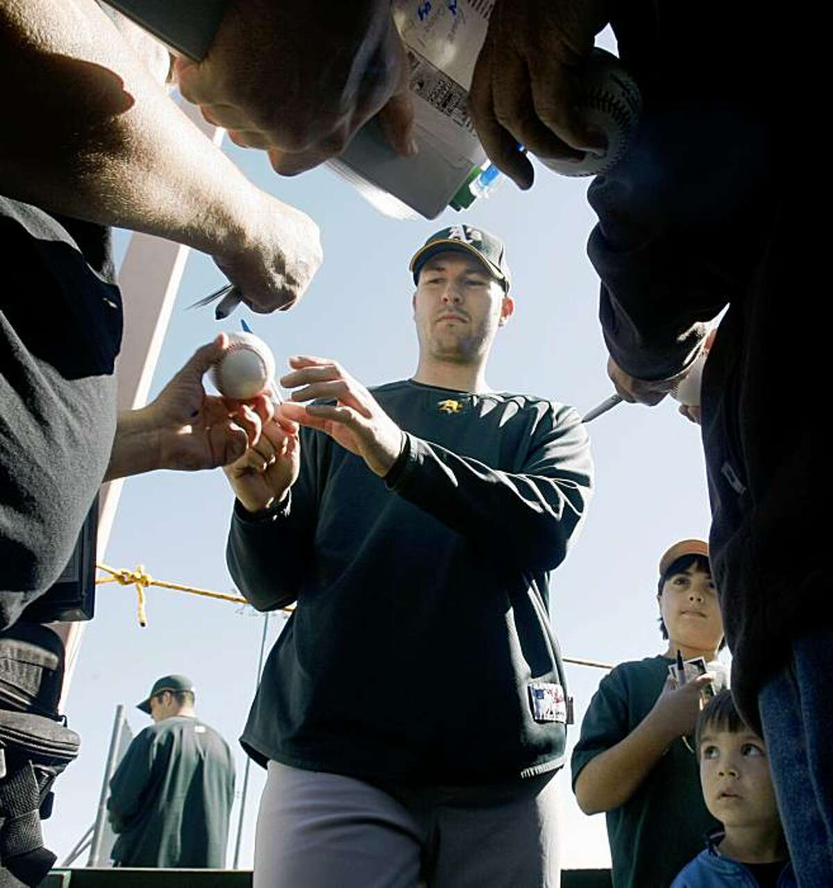 Oakland Athletics pitcher Justin Duchscherer signs autographs at Papago Baseball Complex Thursday February 19, 2009 in Phoenix Arizona