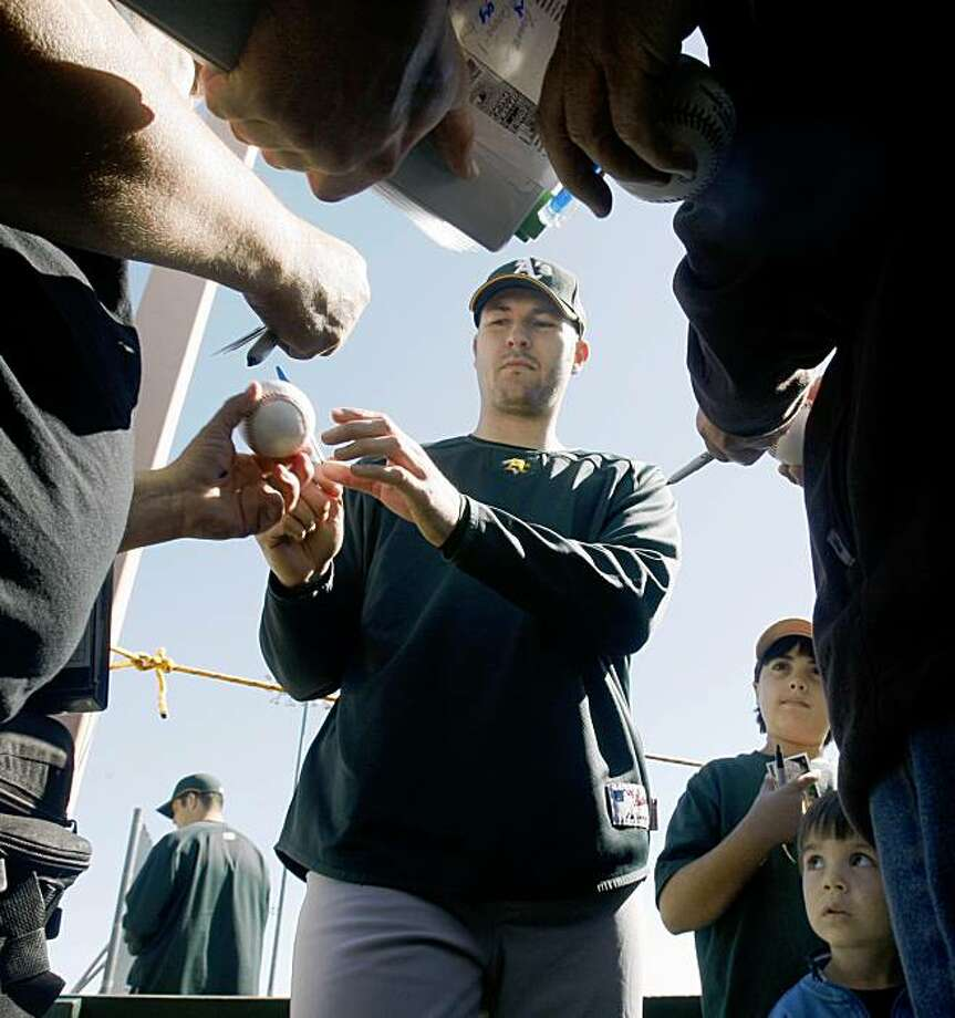 Oakland Athletics pitcher Justin Duchscherer signs autographs at Papago Baseball Complex Thursday February 19, 2009 in Phoenix Arizona Photo: Lance Iversen, The Chronicle