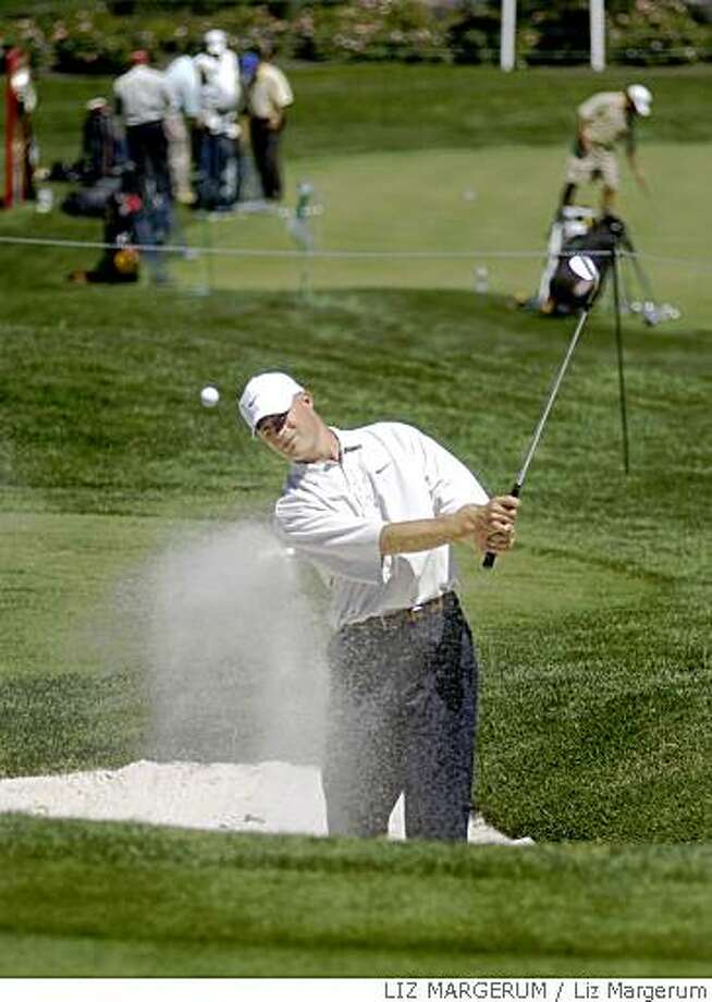 Joel Kribel practices hitting out of the sand trap Tuesday August 17, 2004  at Montreux in Reno, Nev. The Reno Tahoe Open begins Thursday.(AP Photo/Reno Gazette-Journal, Liz Margerum) Photo: Liz Margerum, LIZ MARGERUM