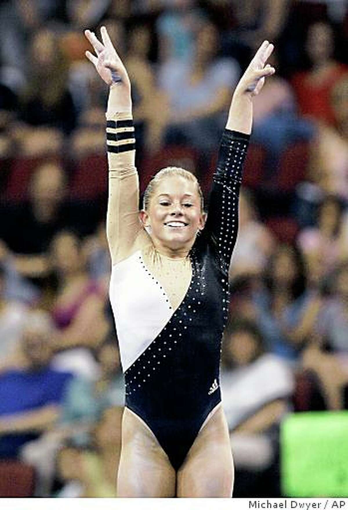 Shawn Johnson raises her arms after finishing her floor routine at the U.S. Gymnastics Championships, Saturday, June 7, 2008, in Boston. (AP Photo/Michael Dwyer)