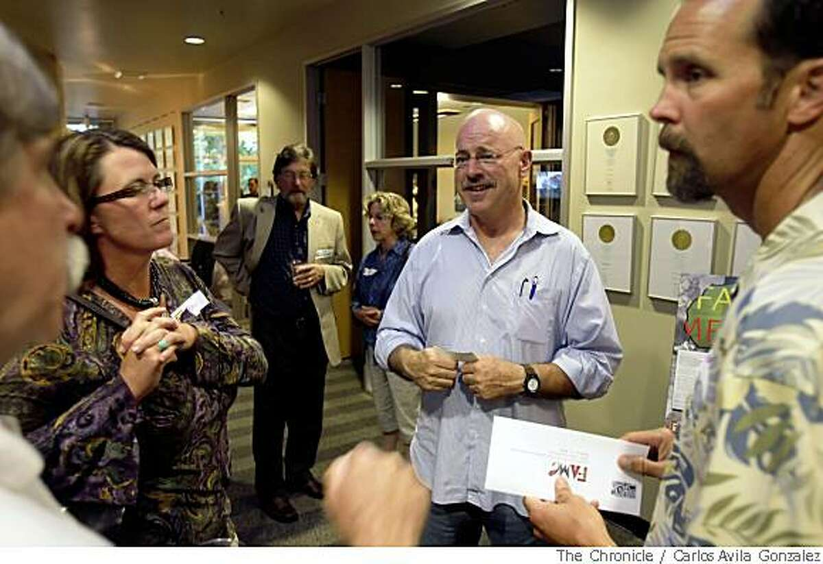 Dr. Frank Artress, second from right, speaks with, l-r, Wayne Kelly, Brandee Ambrosia and her husband, Jeff Ambrosia, at Williams Paddon Architects in Roseville, Ca., during a fundraiser. The architectural firm helped design the clinic Artress built in Tanzania. Dr. Frank Artress, whose story as an African bush doctor was featured in the Chronicle, has been fundraising across the country since the story ran and has seen an increase in the offers for money and time donated to his non-profit. Here he is seen at a fundraiser in Roseville, Calif., on Thursday, May 29, 2008.