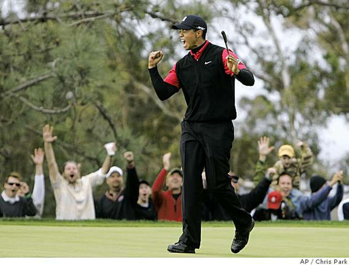 ** ADVANCE FOR WEEKEND EDITIONS, JUNE 7-9 ** FILE ** In this Jan. 27, 2008 file photo, Tiger Woods and the gallery celebrate his birdie on the 11th hole of the South Course at Torrey Pines during the final round of the Buick Invitational golf tournament in San Diego. Woods had surgery on his left knee two days after the Masters, leaving the world's No. 1 player without a competitive round for nearly two months until he tees it up on a Torrey Pines course set up for the U.S. Open. (AP Photo/Chris Park, File)
