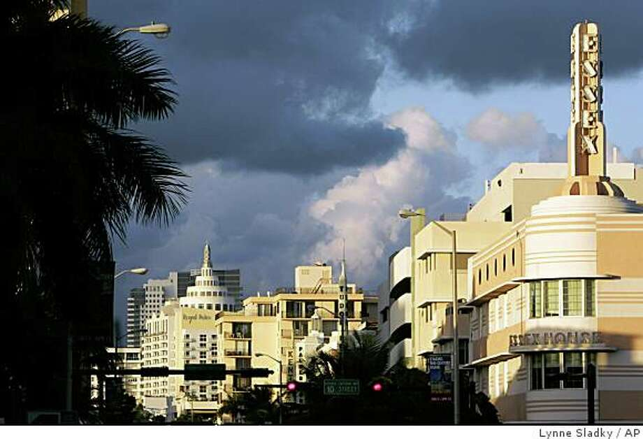 Art deco designed buildings line Collins Avenue in Miami Beach, Fla. Monday, Jan. 7, 2008. Modern day South Beach is still a vibrant monument to the art deco designs of the late 1920's and 30's. Photo: Lynne Sladky, AP