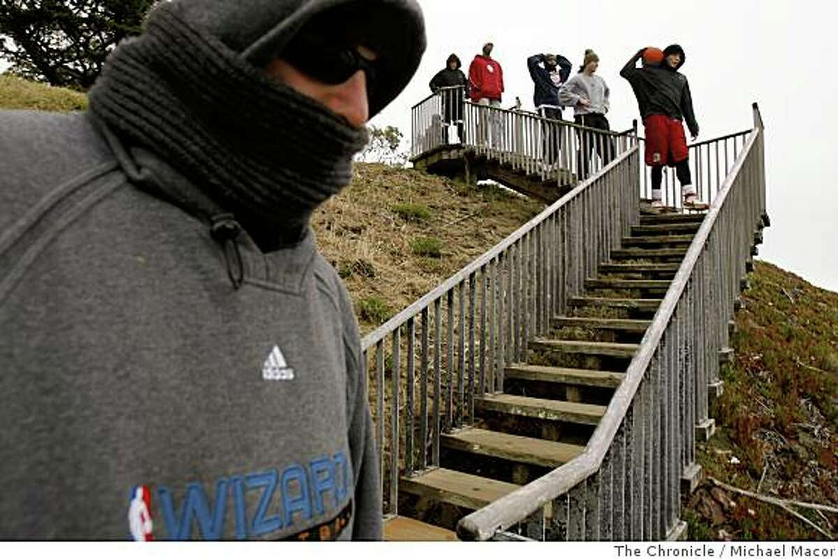 Physical trainer Frank Matrisciano works with his group of players at Golden Gate Heights Park in San Francsico, Calif., using the 116 wooden steps as a training ground, on May 30, 2008.Photo By Michael Macor/ The Chronicle