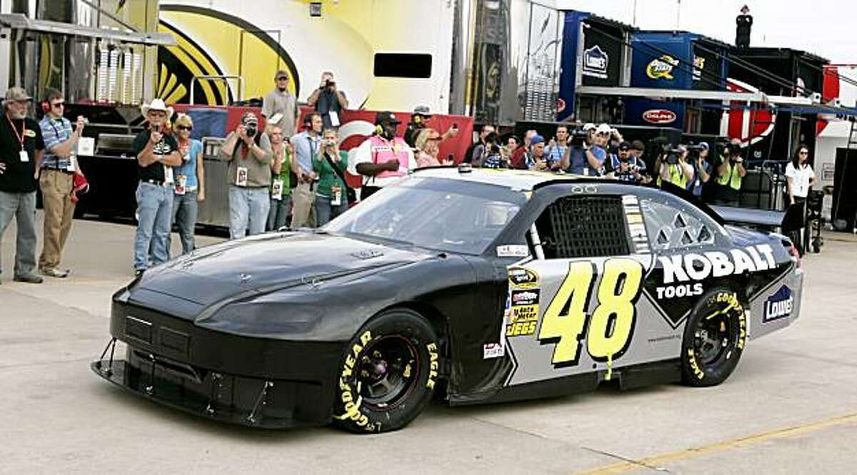 Jimmie Johnson drives his Lowe's Chevrolet car out of the garage following extensive repairs during the NASCAR Sprint Cup Dickies 500 race at Texas Motor Speedway on Sunday, November 8, 2009, in Fort Worth, Texas. Johnson wrecked after lap 2. (Ross Hailey/Fort Worth Star-Telegram/MCT)