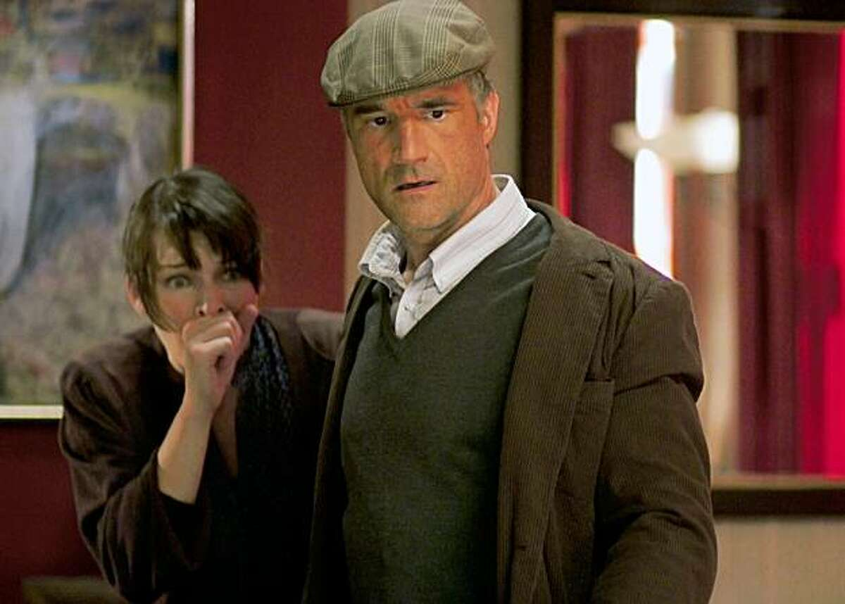 In this film publicity image released by Universal Pictures, Milla Jovovich, left, and Elias Koteas are shown in a scene from,