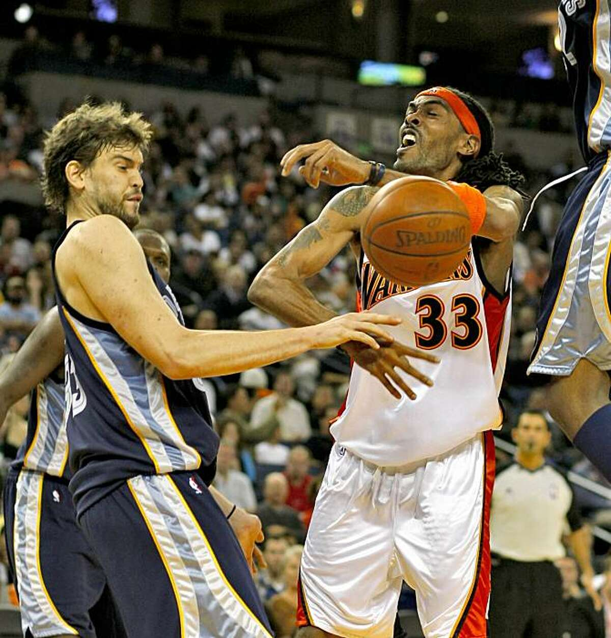 Memphis Grizzlies Marc Gasol fouls Mikki Moore in the third quarter.