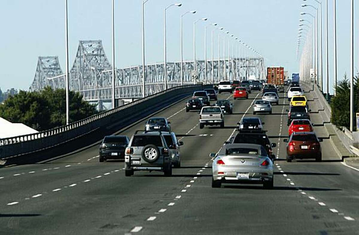 Since being closed for emergency repairs last week, commutes drive over the Bay Bridge for the first time on Monday, Nov. 2, 2009 in Oakland, Calif.