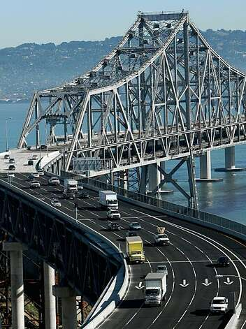 SAN FRANCISCO - NOVEMBER 02:  Traffic flows across the eastern span of the San Francisco Bay Bridge November 2, 2009 in San Francisco, California. The San Francisco Bay Bridge reopened this morning after being closed for six days to undergo emergency repairs of cross beams and rods that broke and fell into traffic damaging three vehicles. (Photo by Justin Sullivan/Getty Images) Photo: Justin Sullivan, Getty Images