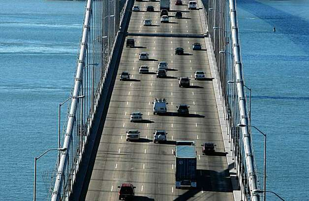 SAN FRANCISCO - NOVEMBER 02:  Traffic flows across the western span of the San Francisco Bay Bridge November 2, 2009 in San Francisco, California. The San Francisco Bay Bridge reopened this morning after being closed for six days to undergo emergency repairs of cross beams and rods that broke and fell into traffic damaging three vehicles.  (Photo by Justin Sullivan/Getty Images) Photo: Justin Sullivan, Getty Images