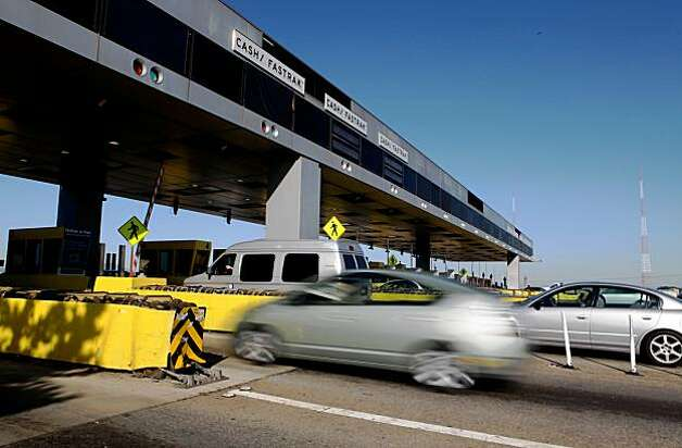 SAN FRANCISCO - NOVEMBER 02:  Traffic passes through the toll plaza of the San Francisco Bay Bridge November 2, 2009 in San Francisco, California. The San Francisco Bay Bridge reopened this morning after being closed for six days to undergo emergency repairs of cross beams and rods that broke and fell into traffic damaging three vehicles.  (Photo by Justin Sullivan/Getty Images) Photo: Justin Sullivan, Getty Images