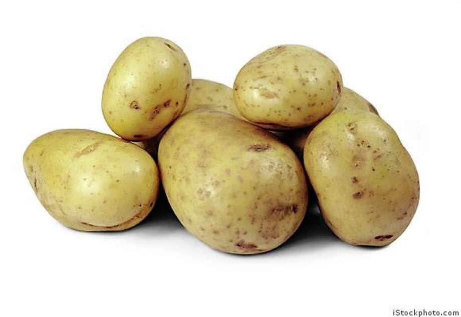 Potatoes isolated on a white background. Photo: IStockphoto.com