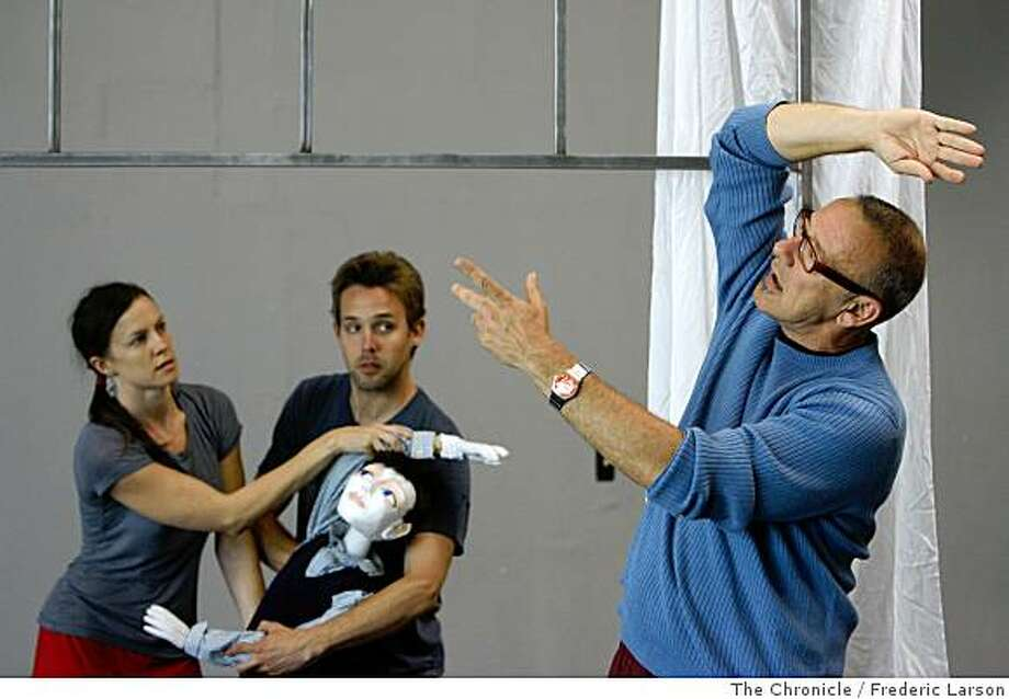 "Joe Goode (far right) works with dancers Jessica Swanson (left) and Alexander Zenzian during a rehearsal of ""Wonderboy"" (a puppet) in Emeryville on May 30, 2008.5/30/08 Photo: Frederic Larson, The Chronicle"