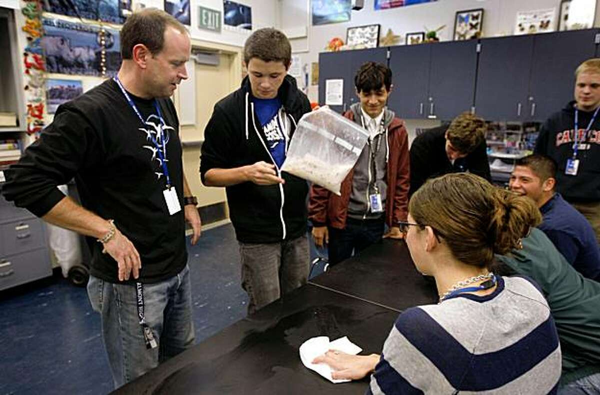 Casey O'Hara (left) helps students make ice cream in his physics class at Carlmont High School in Belmont, Calif., on Friday, Nov. 13, 2009. O'Hara is embarking on an expedition to Antarctica to conduct experiments and will share his experience with the students when he returns.