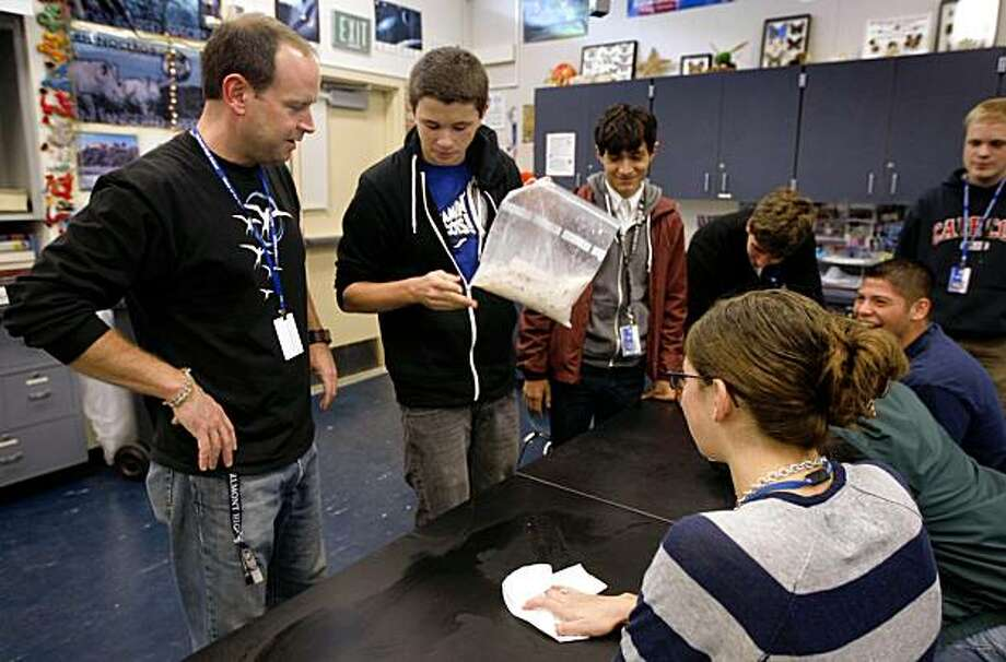 Casey O'Hara (left) helps students make ice cream in his physics class at Carlmont High School in Belmont, Calif., on Friday, Nov. 13, 2009. O'Hara is embarking on an expedition to Antarctica to conduct experiments and will share his experience with the students when he returns. Photo: Paul Chinn, The Chronicle