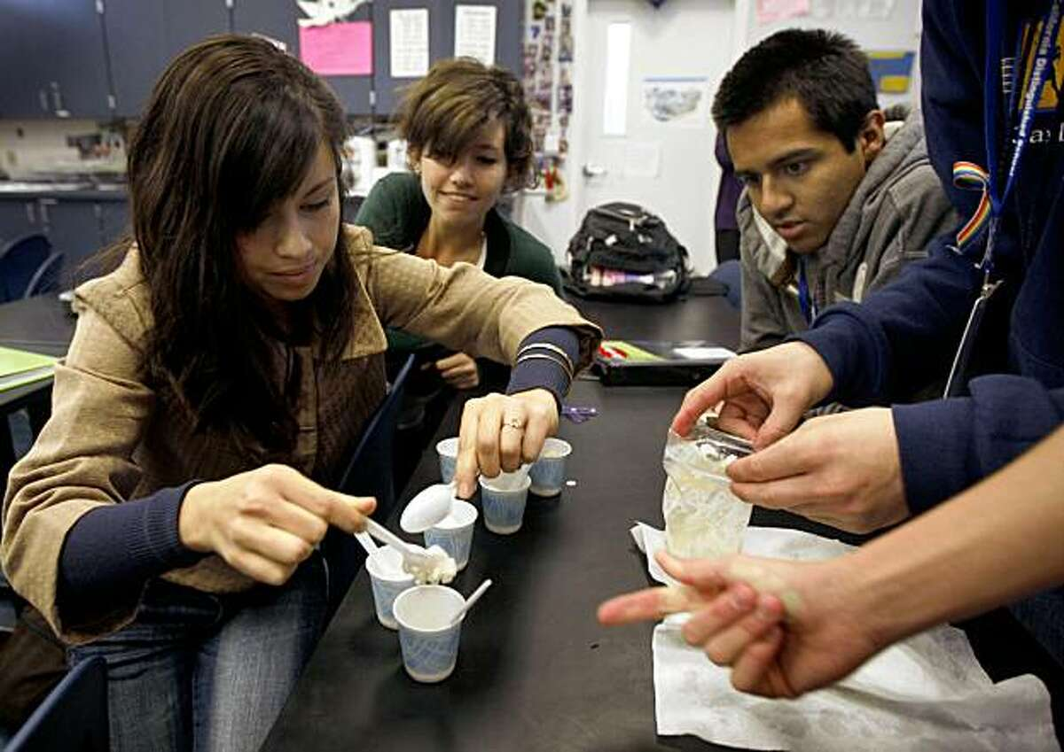 Audrey Harris spoons out ice cream students made in Casey O'Hara's physics class.