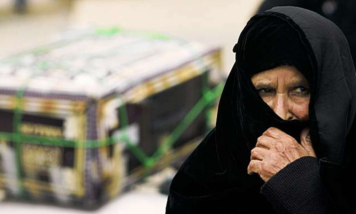 An elderly Palestinian woman looks on as she arrives in Gaza from Egypt, at the Rafah crossing border, southern Gaza Strip, Sunday, Nov. 1, 2009. The Palestinians on Sunday rejected Secretary of State Hillary Clinton's call for the unconditional resumption of peace talks, suggesting that U.S. toleration for continued settlement construction was undermining efforts to break the impasse. (AP Photo/Eyad Baba)
