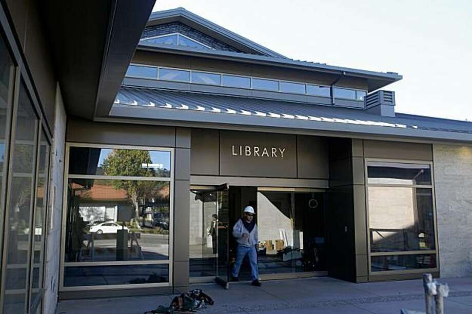 Workers put finishing touches on the soon to be opened Lafayette Library on Thursday, Oct. 29, 2009 in Lafayette, Calif. Photo: Mike Kepka, The Chronicle